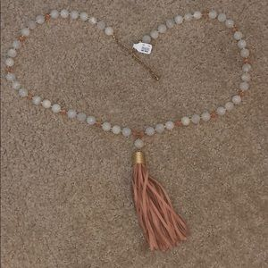 Long beaded necklace with suede pendant
